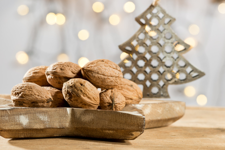 christmas tree: Walnuts with Christmas tree on the wooden table
