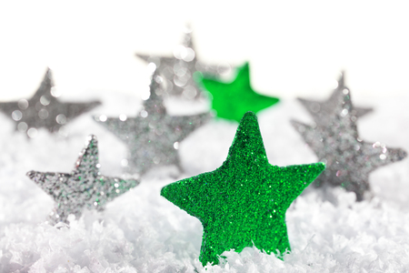 christmas star: Green Christmas star with silver stars on the snow Archivio Fotografico