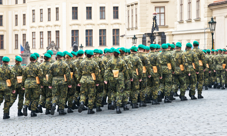 stone road: company of soldiers marches on the stone road in the Prague Castle Stock Photo