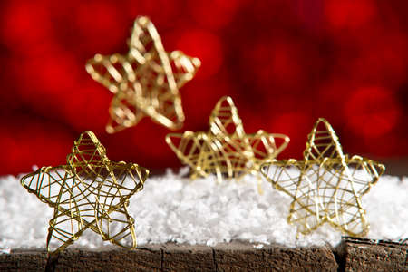 red and gold: Golden Christmas stars on the red background Stock Photo