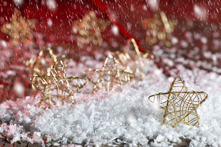 snows: Christmas stars in the snow on the red background