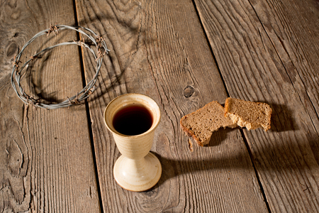 chalice bread: Chalice, bread and crown of thorns on the wooden table