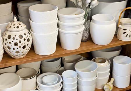 storeroom: new white clay pots in the florist shop