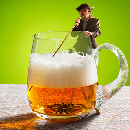 the drinker: drinker is drinking beer with a straw