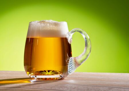 background green: beer on the table with green background