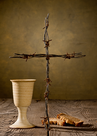 chalice: Chalice, bread and cross on the wooden table