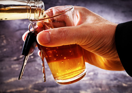 taster: man holding glass of liquer and car key Stock Photo