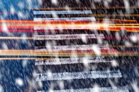pedestrian crossing: pedestrian crossing by night in the snowfall Stock Photo