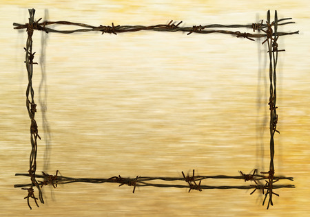 barbed wire frame: frame from rusty barbed wire on the brown background Stock Photo