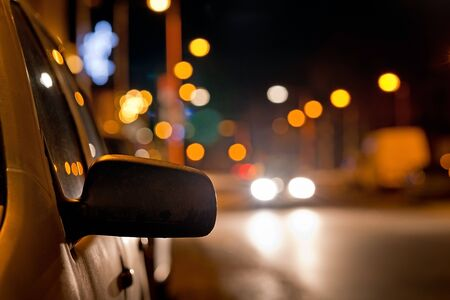 rearview: rear-view mirror of the car on the night street