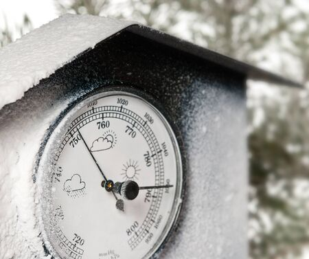 weather gauge: detail of barometer with white frost Stock Photo