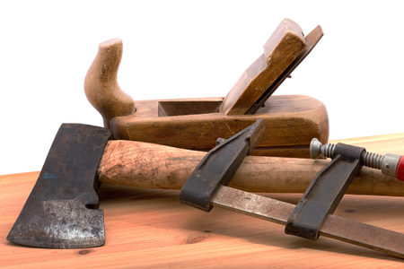 old desk: old used tools on the wooden desk