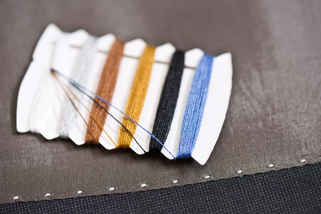 gray clothing: detail of sewing kit on the gray clothing Stock Photo