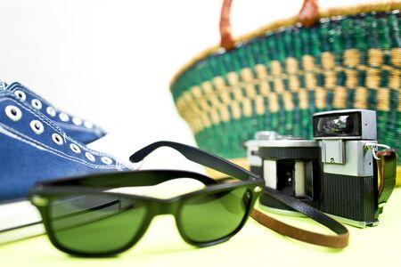 analogue: still life with sneaker analogue camera and handbasket Stock Photo