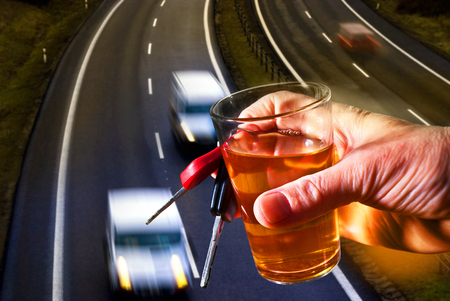 the drinker: hard drinker with liqueur glass and going cars