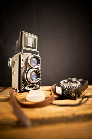 reflex camera: old twin-lens reflex camera with light meter on the black background