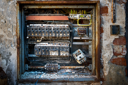 routing: a detail of old broken circuit breakers Stock Photo