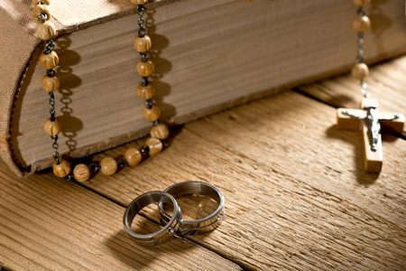 weddings rings, bible and prayer beads