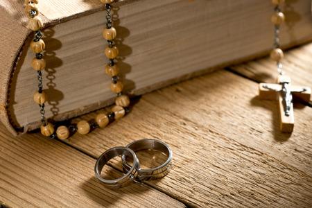 weddings rings, bible and prayer beads
