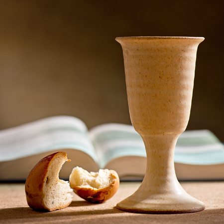 stilllife with chalice of wine, bible and bread