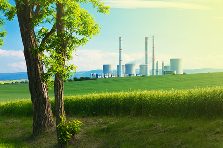 alternative energy sources: landscape with a tree and power station