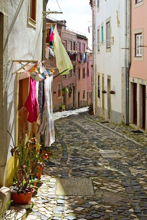 cramped: A narrow street in Alfama district in Lisbon, Portugal