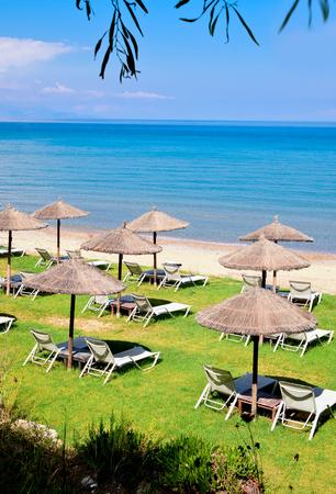 sunshades: Sun beds on beach in Zakynthos, Greece