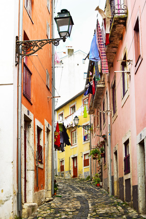 cobbled: A narrow street in Alfama district in Lisbon, Portugal