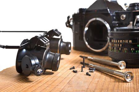 old analoque camera wirh screws and screwdriwer