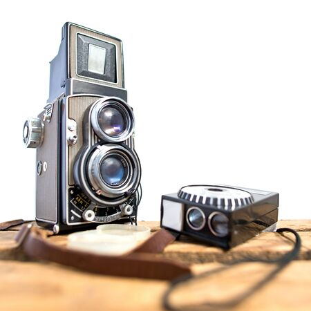 reflex camera: old twin-lens reflex camera with light meter on the white background