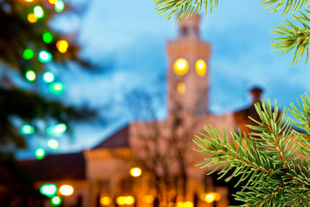 castles needle: Christmas background with old town hall and christmas twig Stock Photo