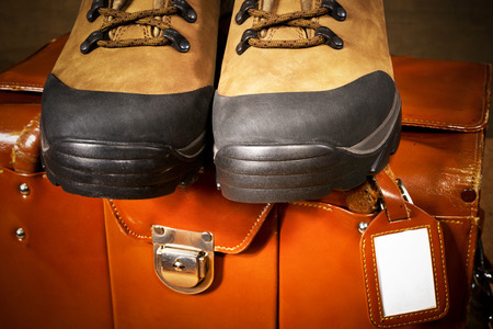walking boots: detail of walking boots and travel bag Stock Photo