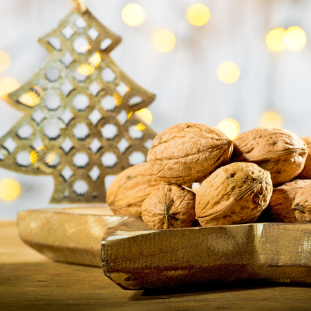 Wallnuts with Christmas tree on the wooden table