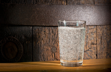 carbondioxide: a glass of mineral water on the dark background