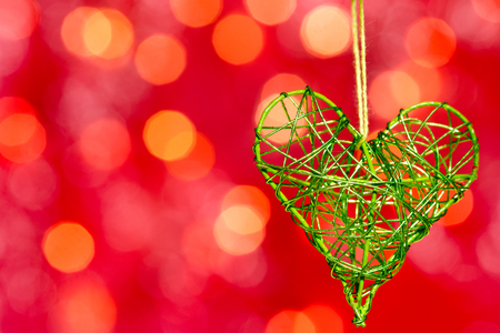 heart from metal on the red background