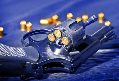 detail of a revolver with blank cartridge Stock Photo