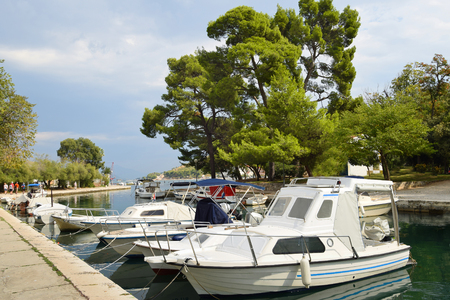 Boats anchor at the seafront in Trogir - town and harbour on the Adriatic coast