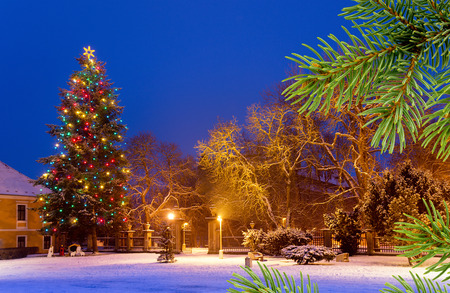 Christmas tree in the snow town by night Stock Photo