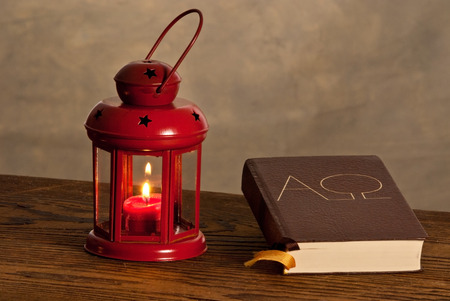 Red lantern with bible on the wooden desk Stock Photo