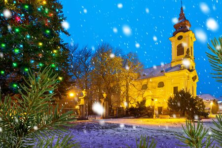 Catholic church with Christma tree in the Christmastime Stock Photo