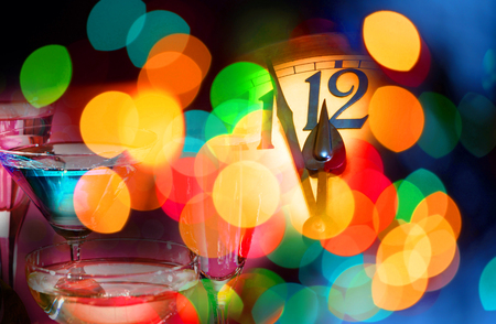 face of new year clock with colored decoration Stock Photo