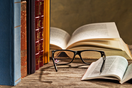 reading glasses: reading glasses with bokks on the table