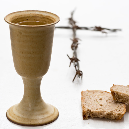 Chalice Of Wine With Bread On The Table Stock Photo