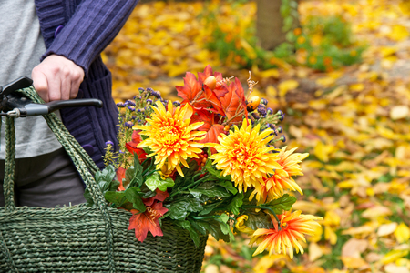 Woman with Flower Bouquet in the Shopping Bag