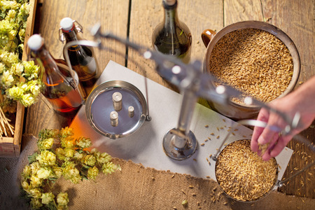 Home Brewing of Beer. Man Weighs Barley. View Above. Stockfoto