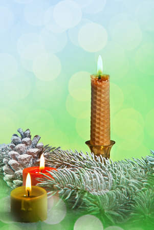 Three Christmas Candles on the Blue Green Background Stock Photo