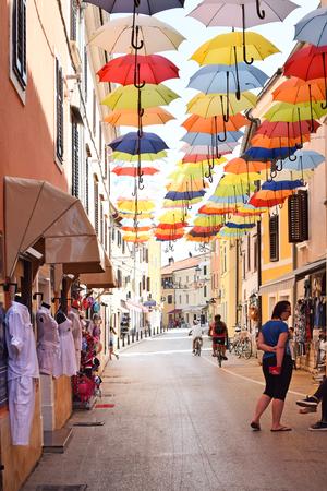 NOVIGRAD, CROATIA - AUGUST 31, 2017: Narrow winding street in Novigrad. Novigrad is a small Istrian coastal town with narrow winding streets; small shops and pleasant cafés. Editorial