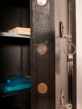 Detail of Open Safe with Bunch of Keys Stock Photo