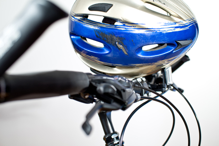 Old Scraped Safety Helmet On The Bike Stock Photo