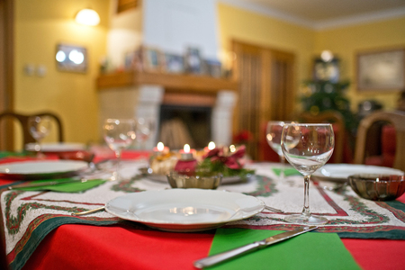 Empty plate with cutlery on the Christmas table. Stock Photo
